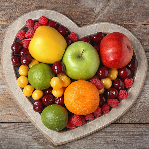 Fresh fruits arranged in heart-shaped bowl