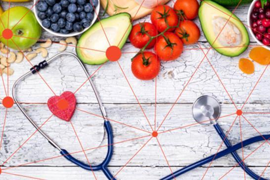 Colourful fruit and vegetables, and a stethoscope on a wooden background painted white